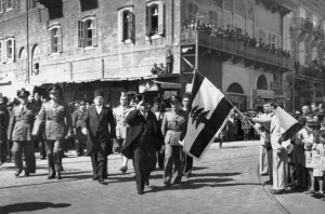 LEBANON, Beirut : A picture dated 22 November 1945 shows President Bishara al-Khoury saluting the Lebanese flag during the first Lebanese military Parade at Beirut's martyrs square after the withdrawal of French troops from Lebanon. SAMI SOLH ALBUM / AFP
